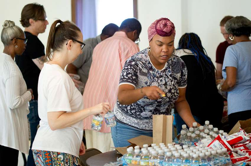 Parishioners at Holy Name of Jesus Church in Washington pack lunches for the poor June 25. More than 50 meals were distributed that day.