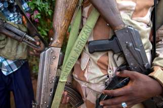 Armed militia fighters display weapons in the town of Koui, Central African Republic, on April 27, 2017.