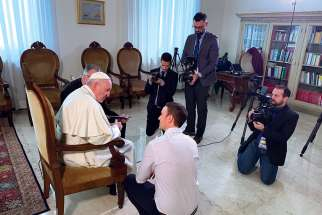 Sebastian Gomes chats with Pope Francis prior to shooting a scene of The Francis Impact at the Vatican.