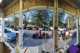 "The view from inside ""Fr. Gerard's COVID Shack"" where Fr. Gerard Monaghan presides over Sunday drive-in Masses at St. Faustina Church in Cumberland, Ont."