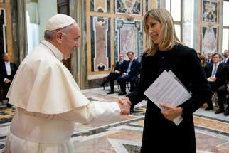 "Pope Francis greets Simona Agnes, who presides over the Biagio Agnes Prize, which honors professional journalism. He praised a delegation for promoting reporting that puts the truth ""before personal interests or the interests of corporations."""
