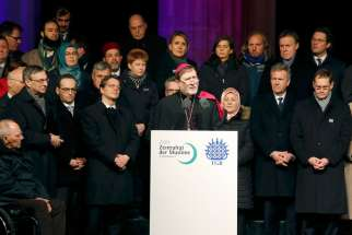 Auxiliary Bishop Matthias Heinrich of Berlin makes remarks during a Jan. 13 vigil in front of the Brandenburg Gate. The vigil was organized by Muslim groups for the victims of the Jan. 7 shootings by gunmen at the Paris offices of the satirical weekly newspaper Charlie Hebdo