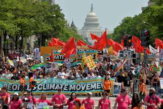 Demonstrators join the People's Climate March in Washington to protest President Donald Trump's stance on the environment April 29.
