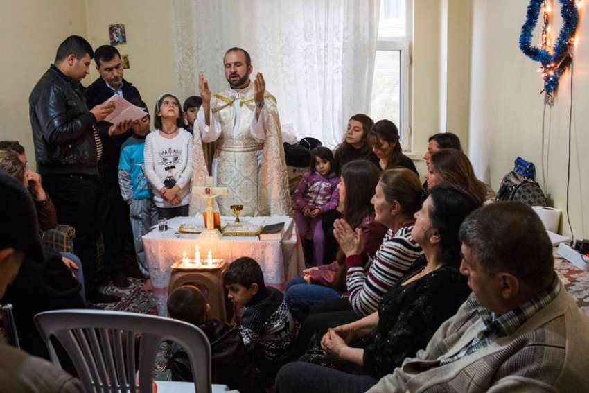 Chaldean Father Remzi Diril, also known as Father Adday, celebrates Mass at an apartment in Kirsehir, Turkey, Nov. 10.