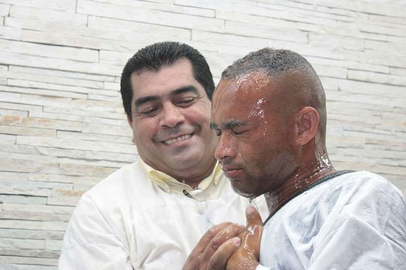 A man getting baptized.