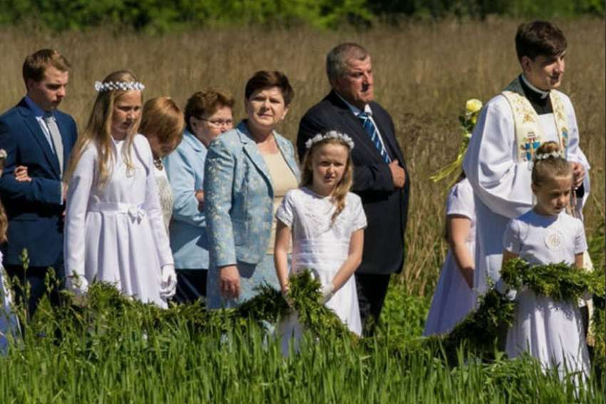 25-year-old Father Tymoteusz Szydlo, far right, celebrated his first Mass May 28. He is the son of Polish prime minister Beata Szydlo, second from right.