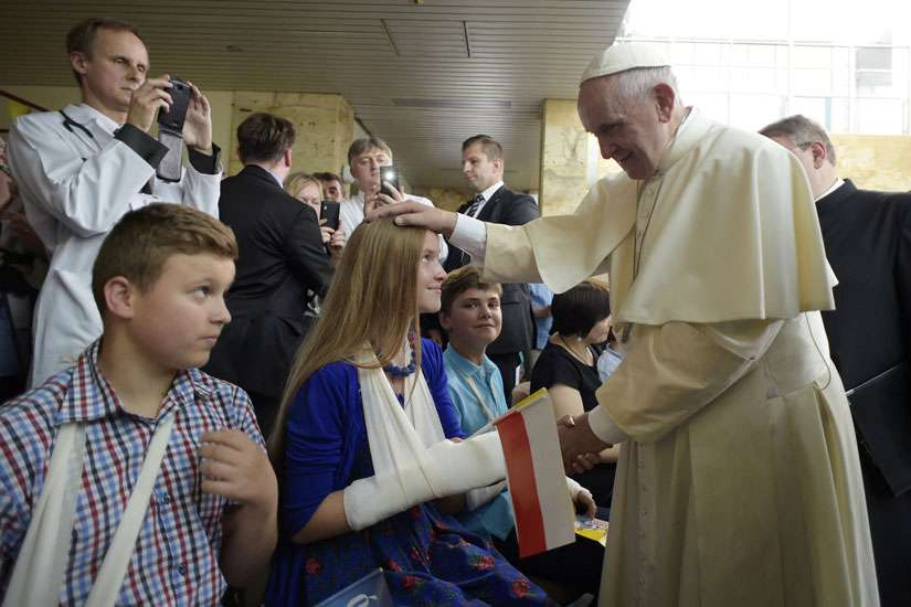 Pope Francis blesses children during a visit to the Children's University Hospital in Krakow, Poland, July 29.