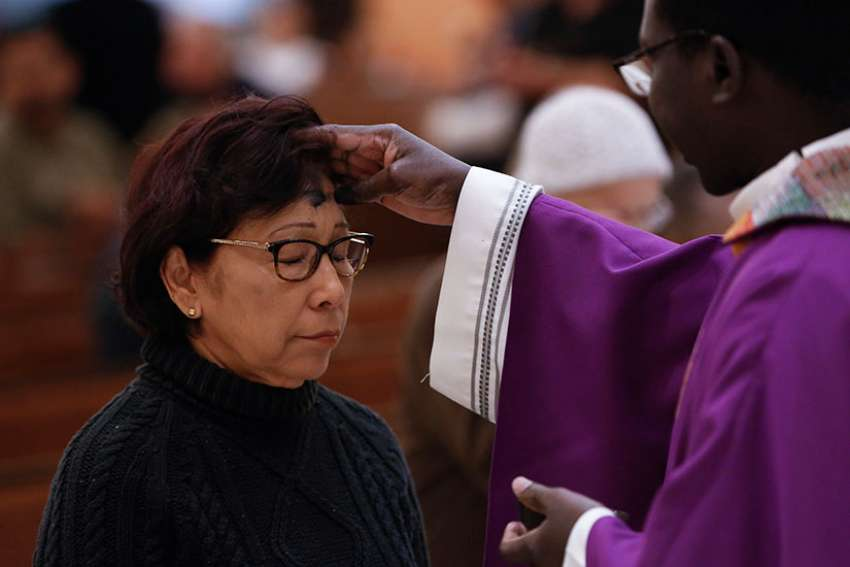 Ashes are distributed at St. Helen Church in Glendale, Arizona, in this 2016 file photo. Ash Wednesday -- March 1 this year in the Western church calendar -- marks the start of Lent, a season of sacrifice, prayer and charity.