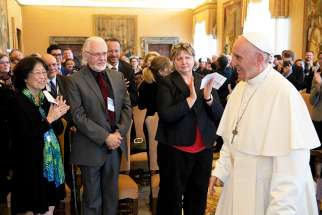 Pope Francis leads an audience with members of the International Federation of Catholic Universities at the Vatican Nov. 4. The pope encouraged Catholic universities to study the root causes of migration.