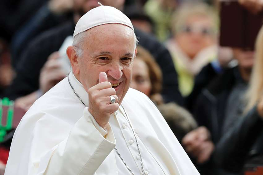 Pope Francis gives the thumbs up as he arrives to lead his general audience in St. Peter's Square at the Vatican Oct. 31.
