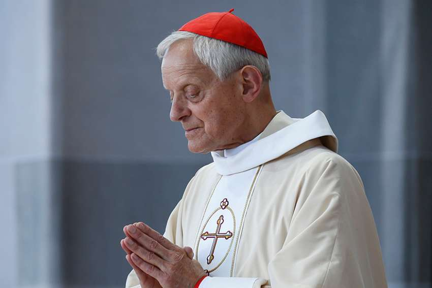 Cardinal Donald W. Wuerl of Washington is pictured as Pope Francis celebrates Mass in Washington Sept. 23, 2015.