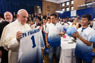 Pope Francis receives a Catholic Charities jersey and an autographed soccer ball Sept. 2015.