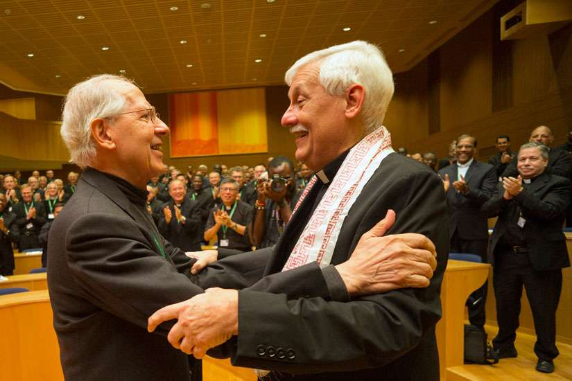 Jesuit Father Arturo Sosa, right, the new superior general of the Society of Jesus, greets the previous superior general, Jesuit Father Adolfo Nicolas, after his election in Rome Oct. 14. Father Sosa, 67, is a member of the Jesuits' Venezuelan province.