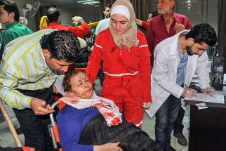 A wounded Syrian woman receives aid at a hospital April 7 in Damascus after a suspected chemical-weapon attack in Douma. Pope Francis condemned the use of chemical weapons after the deadly attack killed dozens of innocent men, women and children.