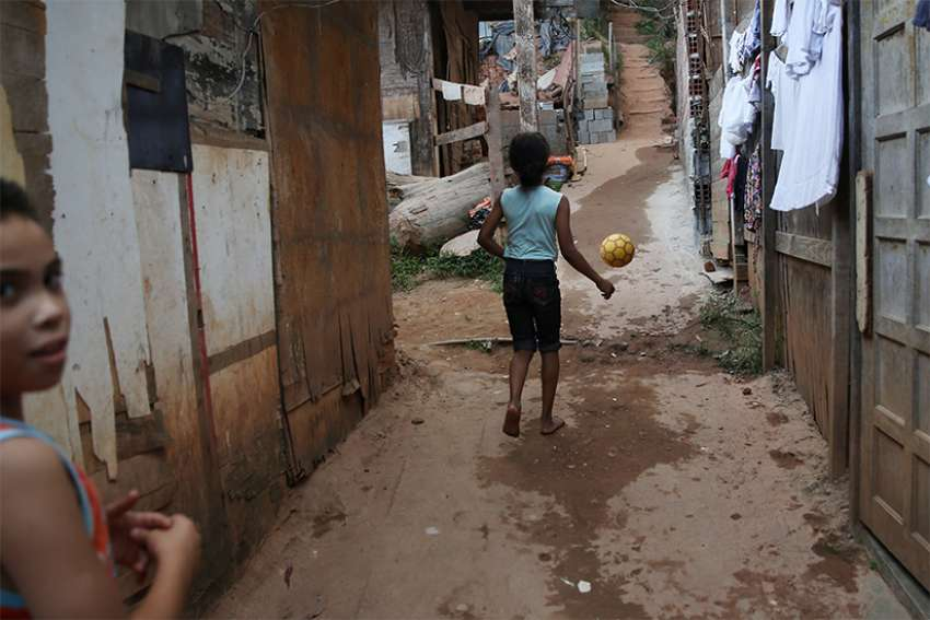 Girls play in the Tribo neighbourhood near Sao Paulo, Brazil, May 16. The World Day of the Poor – to be marked each year on the 33rd Sunday of ordinary time – will be celebrated Nov. 18.