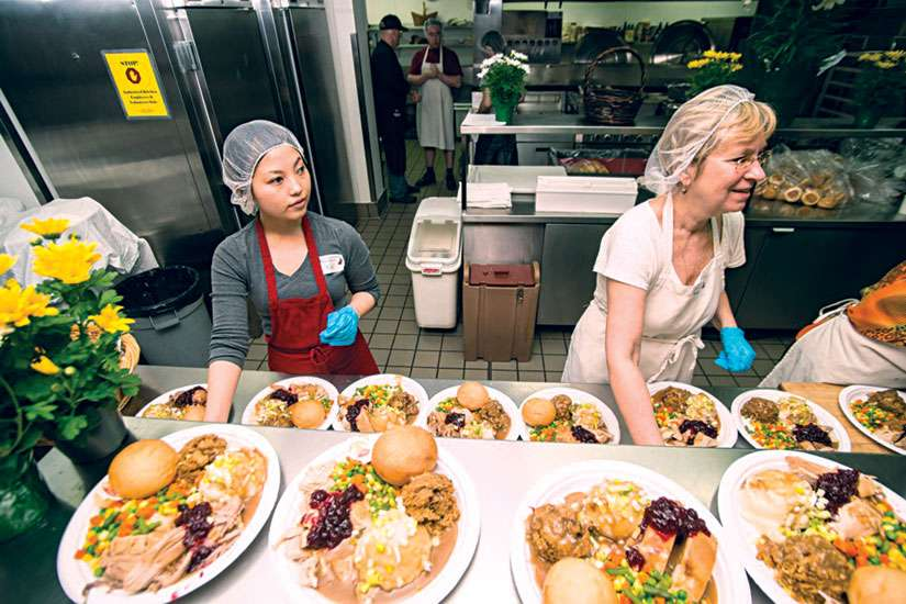 Volunteers prepare the Thanksgiving dinners for patrons of the Good Shepherd Centre in downtown Toronto. The Good Shepherd has recently turned to social media in efforts to raise money for its programs. The hashtag #FastTurkey is aiming to raise $10,000.
