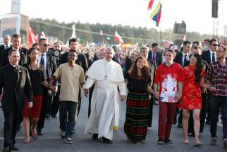 Pope Francis walks with World Youth Day pilgrims July 30, 2016. The upcoming Synod of Bishops' focus is on youth.