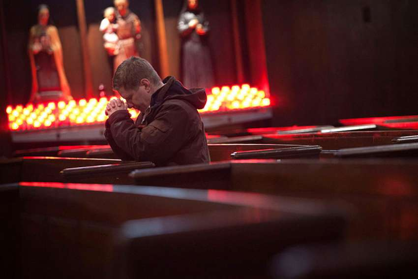 A man prays during Ash Wednesday Mass at St. Andrew's Church in the Manhattan borough of New York March 5, 2014.
