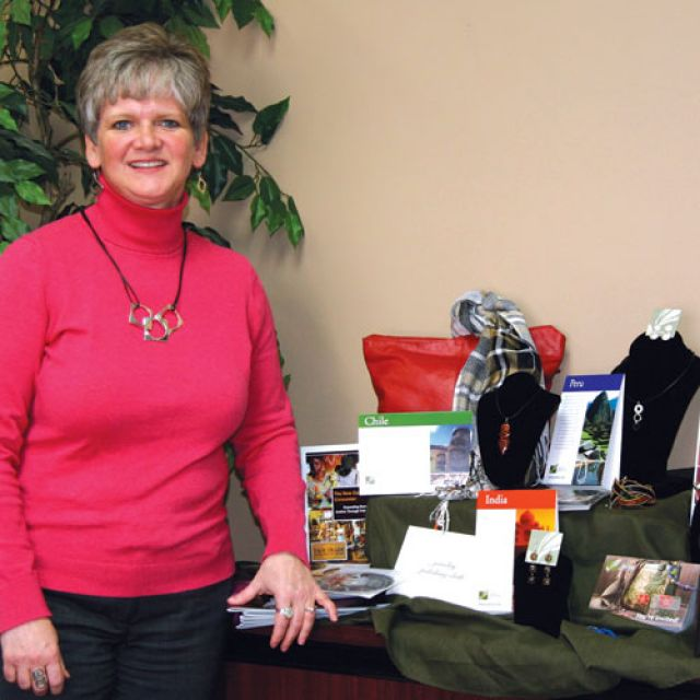 With products from around the world, Jolica's founder Darlene Loewen shows off the diversity of her fair trade company.