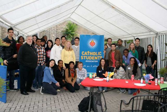 Ryerson University's Catholic Students' Association gather old and new members in the backyard of St. Michael's Cathedral for its start of the school year BBQ.