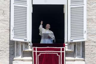 "Pope Francis leads the ""Regina Coeli"" prayer from the window of his studio overlooking St. Peter's Square at the Vatican May 21."