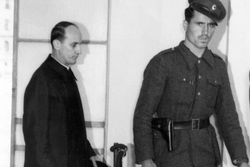 Blessed Alojzije Stepinac, left, enters a Zagreb courtroom in 1946. A commission of Croatian and Serbian experts studying Cardinal Stepinac's life said they were unable to reach a conclusion on questions regarding the controversial martyr's history.