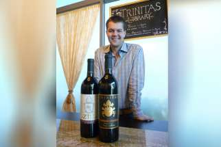 Garrett Busch, CEO of Napa Valley's Trinitas Cellars, with two wines that honor popes — RatZINger Zinfandel and Cabernet FRANCis.