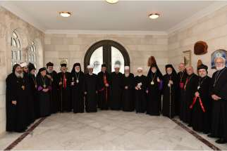 "Catholic, Orthodox and Muslim religious leaders meet for an interfaith summit in Bkerke, Lebanon, March 30. They affirmed the ""essential role"" of the Christian presence in the Middle East and called for terrorism in the region to be confronted culturally , educationally and politically."
