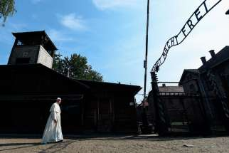 Pope Francis enters the main gate of the Auschwitz Nazi death camp in Oswiecim, Poland, July 29.
