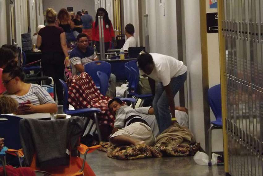 Some of the estimated 4,000 people prepare to spend the night at Largo High School as Hurricane Irma bore down on Largo, Fla., Sept. 9.