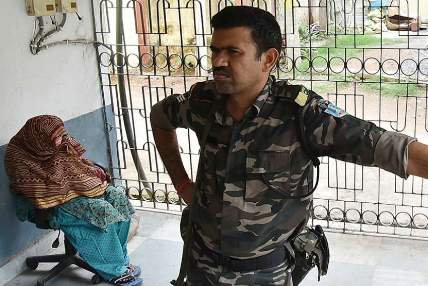 An unidentified Indian woman, allegedly an employee at a home run by Mother Teresa's Missionaries of Charity, is seen in police custody after she was arrested in Jharkhand, India, July 5. Anima Indwar, who worked for the nuns in Jharkhand, was handed over to police in early July after she admitted that procedures had not been followed in transferring children to Jharkhand state's Child Welfare Committee.