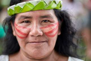 A woman participates in a march of indigenous people through the streets of Atalaia do Norte in Brazil's Amazon region March 27, 2019. The Vatican was to release the working document for the Synod of Bishops for the Amazon June 17.