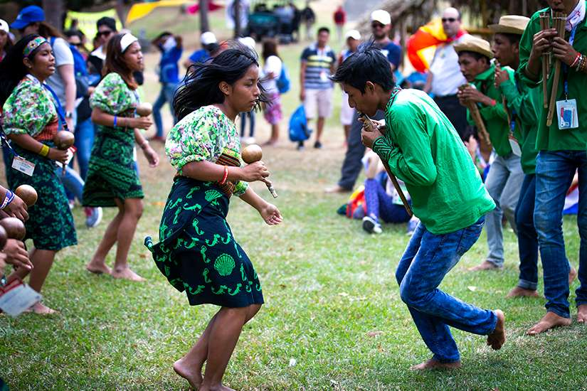 Indigenous World Youth Day pilgrims do a traditional dance during an opening-day performance in a Panama City park Jan. 22, 2019.