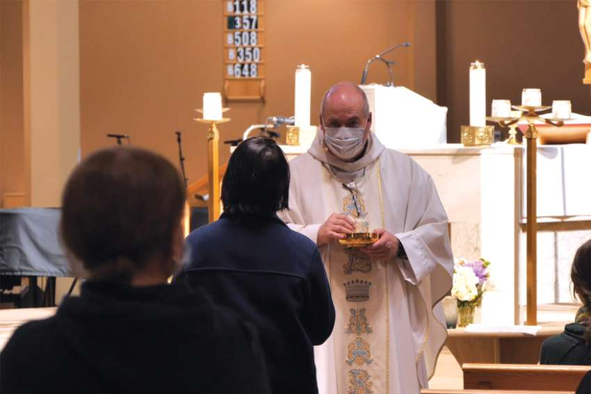 Fr. Jim Corrigan, pastor of Our Lady of Perpetual Help Church in Sherwood Park, Alta., celebrates Mass June 1.