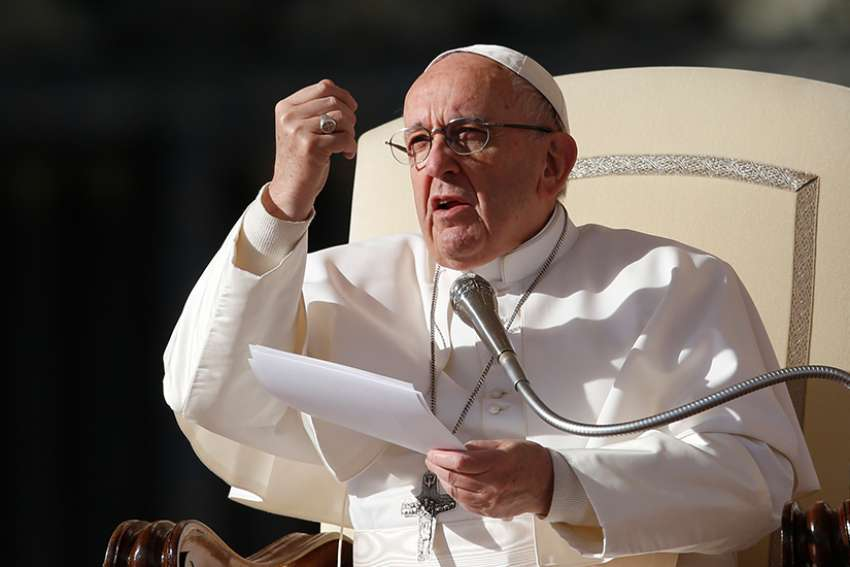 Pope Francis speaks during his general audience in St. Peter's Square at the Vatican Nov. 22.