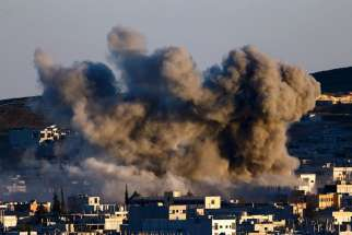 Smoke rise over Syrian town of Kobani after an Oct. 21 airstrike.