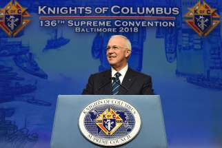 Carl Anderson, CEO of the Knights of Columbus, smiles as he addresses attendees Aug. 7 at the 136th annual Knights convention in Baltimore. Anderson spoke of the charitable works of the Knights, their ongoing pro-life commitment and pledge to support persecuted Christians in Iraq and Syria.