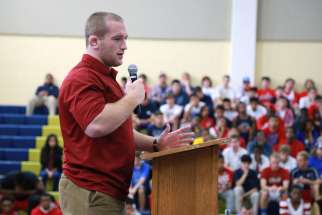 Olympic wrestler Kyle Snyder speaks to students at Our Lady of Good Counsel High School in Olney, Md., Sept. 23, 2015. The former student is headed to Brazil to compete in the Summer Games.