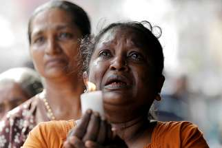 A woman weeps during a memorial service for victims in Colombo, Sri Lanka, April 23, 2019, two days after a string of suicide bomb attacks on churches and luxury hotels across the island.