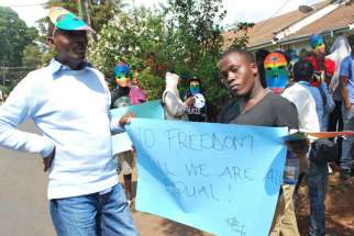 Members of Kenya's gay community hold a sign during a demonstration in Nairobi.