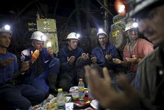 "Coal miners pray deep inside the Stara Jama mine in Zenica, Bosnia and Herzegovina, July 15. The entire mining industry must make ""radical change"" to protect the environment and local communities, Pope Francis says."