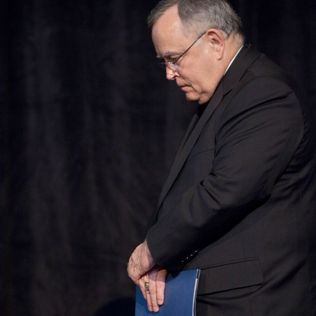Philadelphia Archbishop Charles J. Chaput waits offstage as he is introduced as a speaker at the Catholic Media Conference in Indianapolis June 20. He told the gathering of the deep deficits and other challenges facing his archdiocese. The following day he announced a reorganization that will result in the loss of 40 jobs. The reorganization aims to save the archdiocese from a projected deficit of $17 million in the upcoming year.