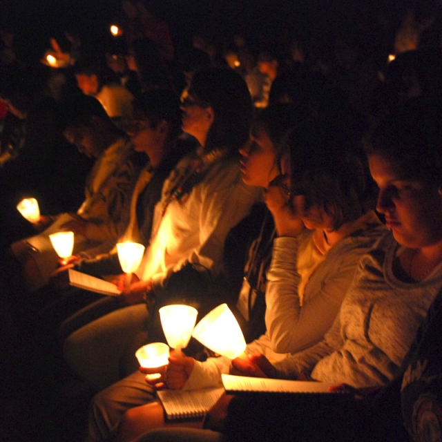 Catholic Youth Rally participants take part in a candlelight Stations of the Cross.