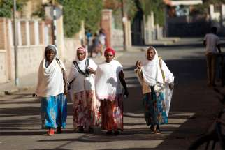 Women walk along a street Feb. 20, 2016, in Asmara, Eritrea.