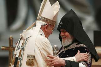 Pope Francis embraces Catholicos Karekin II of Etchmiadzin, patriarch of the Armenian Apostolic Church, during an April 12 Mass in St. Peter's Basilica at the Vatican to mark the 100th anniversary of the Armenian genocide.