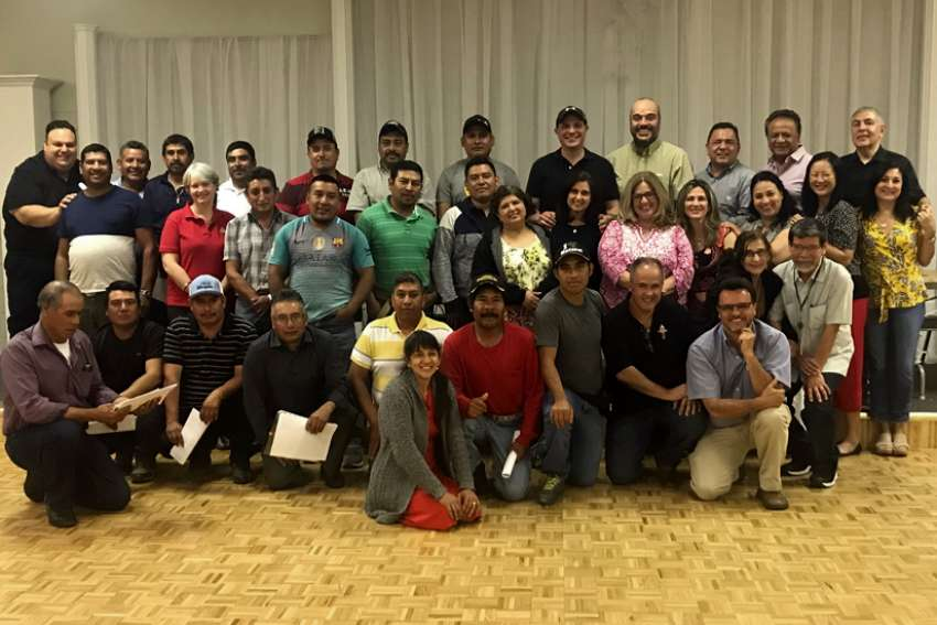 An all-day retreat featuring speakers, food, confession and Mass was held for migrant workers on June 23 at Blessed Sacrament in Burford. Pastor Peter Ciallella is at left in the top row.