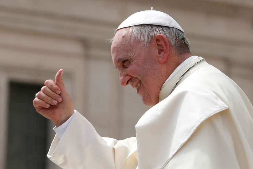 Pope Francis gives a thumbs up as he leaves his general audience in St. Peter's Square at the Vatican May 6.