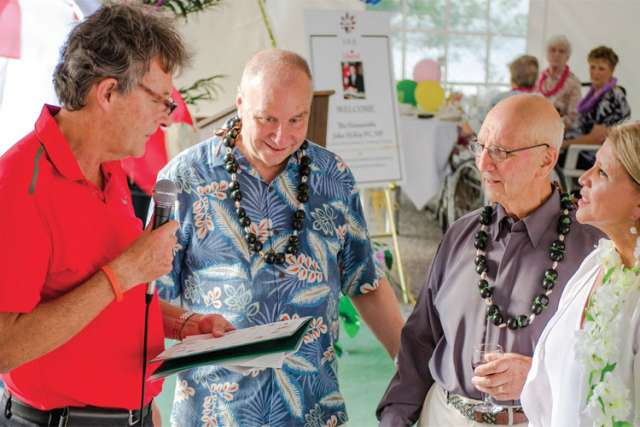 Scarborough Retirement Centre marked its 25th anniversary Aug. 26 with a Hawaiian-themed party. Among the guests were, from left, local MP John McKay, who was welcomed by owners Harold Green, Fred Lafontaine and Josee Lafontaine.