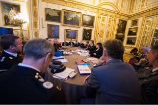 "Delegates against human trafficking attend a conference at Lancaster House in London Dec. 6. Cardinal Vincent Nichols of Westminster said ""there seems to be no enticement that isn't being used"" by human traffickers to entrap children."