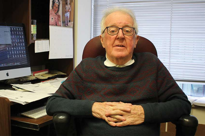 Deacon Doyle sits in his office at The Catholic Register, where he was an accountant for 12 years.